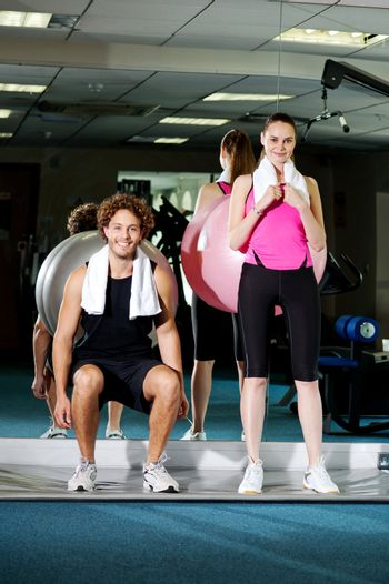 Gym friends working out with the exercise ball
