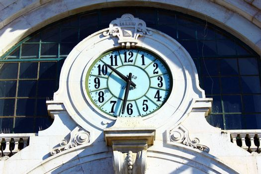 Detail of a clock on the facade of a building