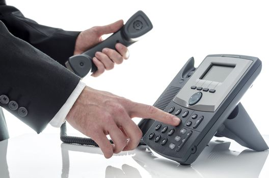 Male hand dialing number