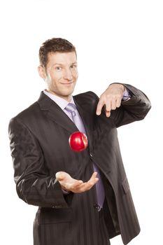 Businessman Tossing Apple