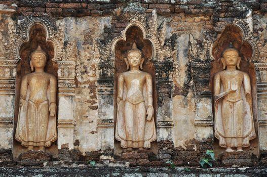 Standing Buddha on chedi 'Suwan Chang Kot' of Wat Ku Kut (Wat Jam Thewee), Lamphun Thailand