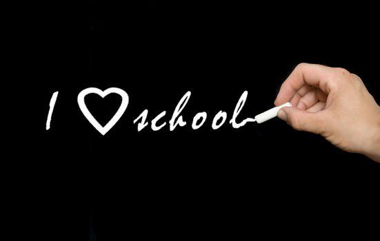 "Writing ""I love school"" on chalkboard"