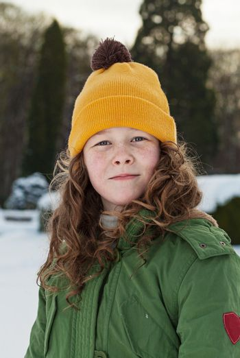 Outdoor winter portrait of a teenager girl