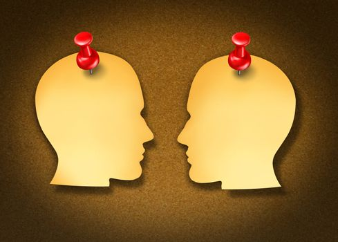 Communication Network strategy with two blank yellow office notes and red thumb tacks in the shape of human heads face to face in a social exchange of information on white.