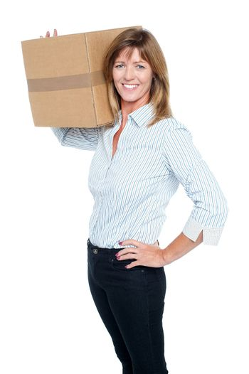 Happy business lady with a box on her shoulder