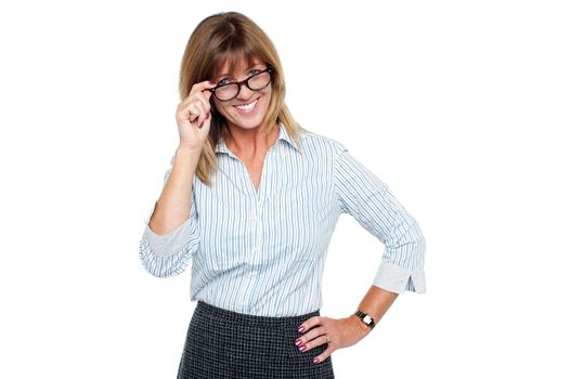 Cheerful corporate lady adjusting her spectacles