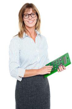 Bespectacled entrepreneur holding calculator