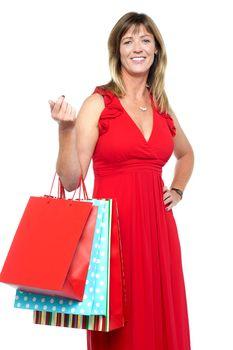 Elegant shopaholic woman carrying shopping bags
