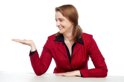 Attractive businesswoman presenting copy space