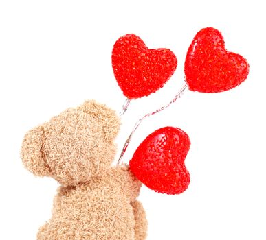 Teddy bear with red balloons