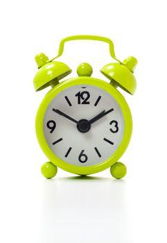 Old fashioned alarm clock isolated on white background.