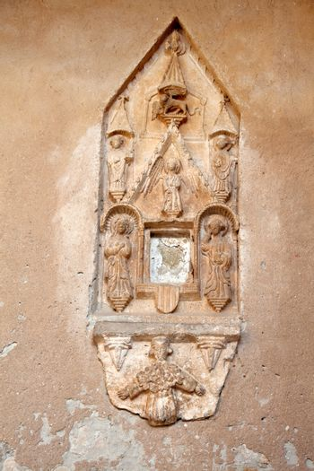 religious stone carving, on the wall