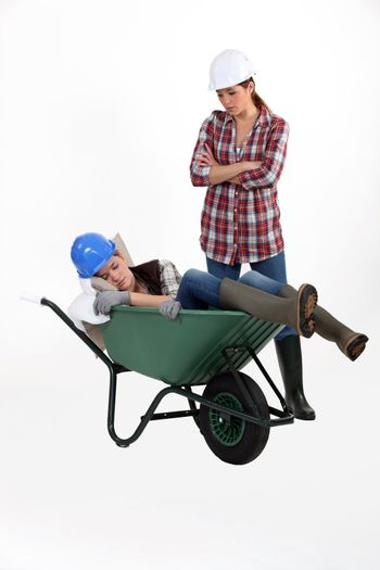 Construction worker discovering her colleague fast asleep