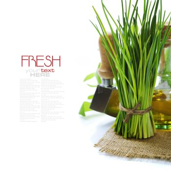 A bunch of fresh chives and olive oil