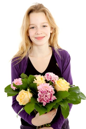 Young girl with bouquet of flowers for mothers day or birthday over white background