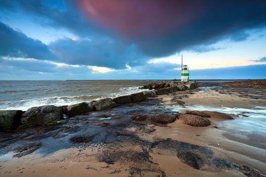 lighthouse on North sea at sunset