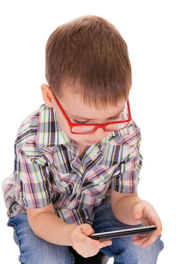 Clever boy plays with his touch smartphone