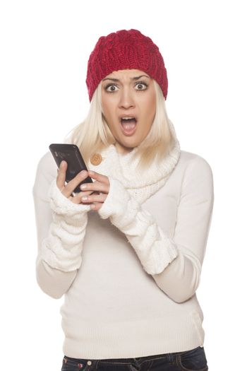 shocked girl reading a text message