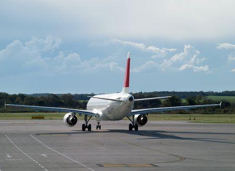 Behind the airplane