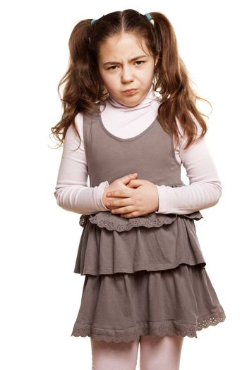 little girl has a stomach pain