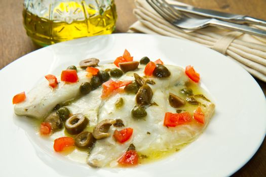 sea bream fillet with tomatoes, green olives and capers