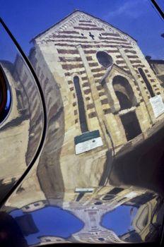 santo stefano church in verona in a reflex of a car