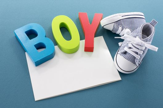 baby boy card with text and shoes