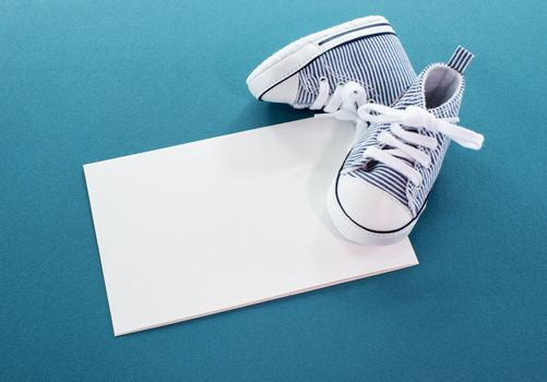 baby boy card with small sport shoes