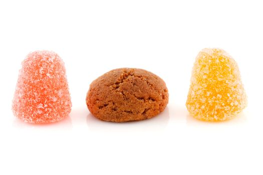 Couple of pepernoten (ginger nuts) and tumtum sweets for typical Dutch festivity at 5 december over white background