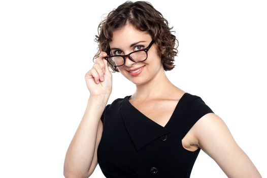 Pretty lady adjusting her eyeglasses