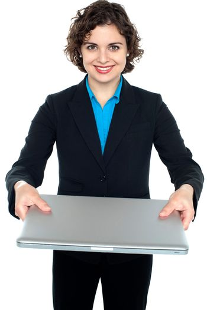 Pretty businesswoman presenting a laptop