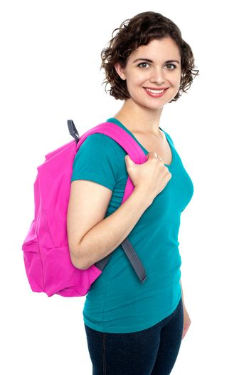 Beautiful female student with pink backpack