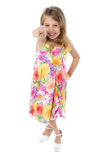 Charming young child pointing at you