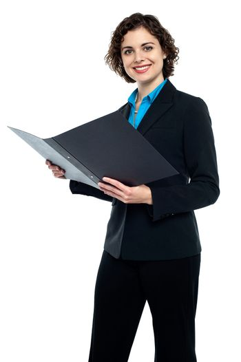 Businesswoman reviewing company documents
