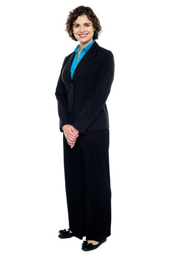 Pretty young business lady in formal attire