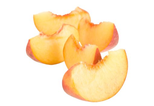 many peaces of peach, isolated on white
