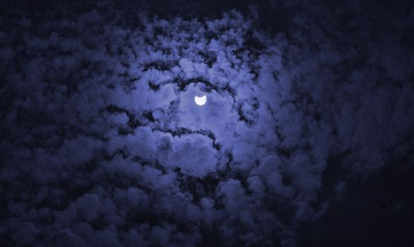 solar eclipse view from blue filter, view from clouds