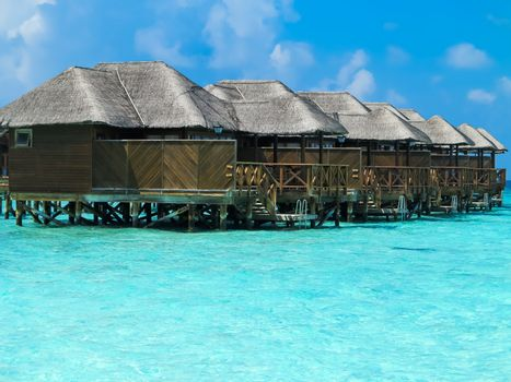 Over water bungalows with steps, Maldives.