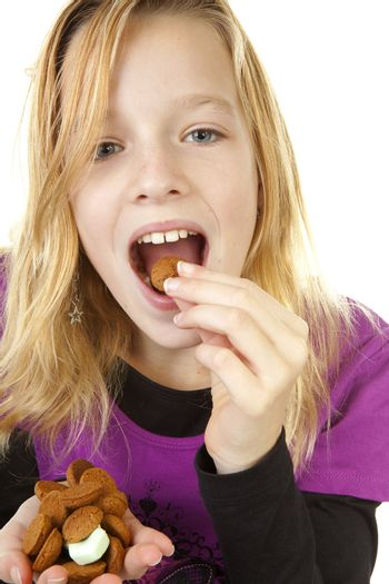 Girl with ginger nuts ( pepernoten ) for Sinterklaas, traditional in the netherlands, over white background
