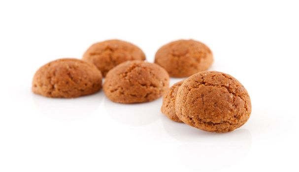 Couple of of pepernoten (ginger nuts) sweets for typical Dutch festivity at 5 december over white background
