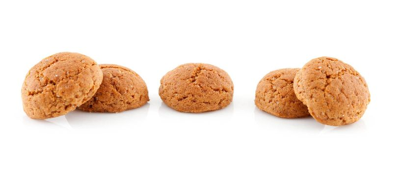 Couple of  pepernoten (ginger nuts) sweets for typical Dutch festivity at 5 december over white background