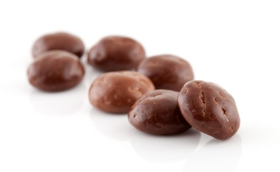 Couple of chocolate pepernoten (ginger nuts) sweets for typical Dutch festivity at 5 december over white background