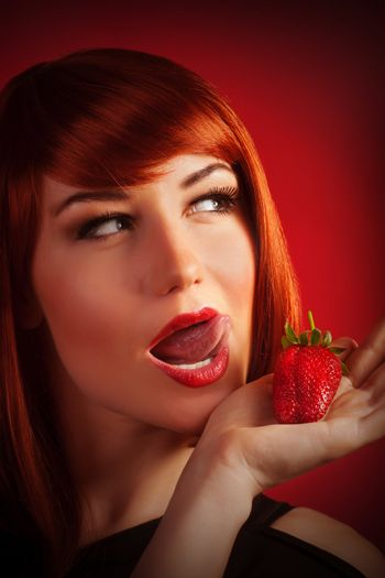 Female with strawberry