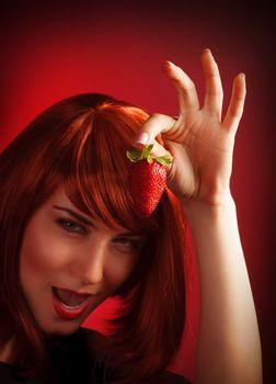 Female holding strawberry