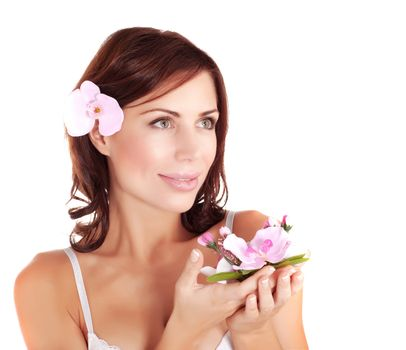 Picture of beautiful female wearing brassiere and holding in hands fresh orchid flower, closeup portrait of lovely woman with black hair, spa salon, beauty treatment, health care, purity concept