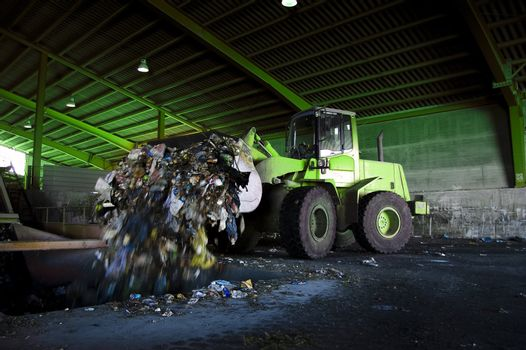 Recycle, overview of refuse collection with bulldozer