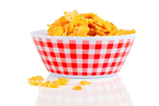 Cornflakes in a porcelain bowl, isolated on white background.