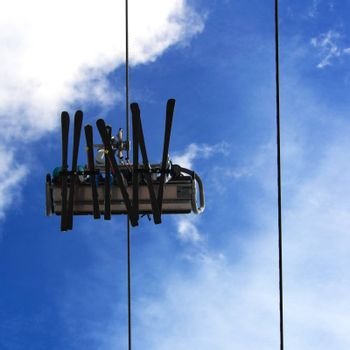 Family on the ski lift, captured from below