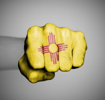 United states, fist with the flag of New Mexico