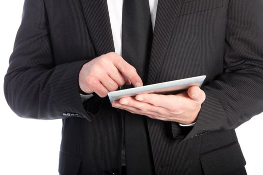 Businessman scrolling on a tablet